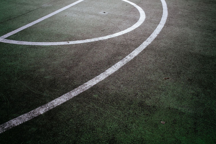 White lines on green basketball court