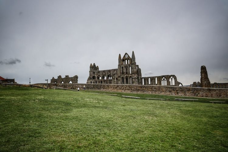 Whitby Whitby Whitby Abbey Architecture Building Exterior Built Structure Grass Sky Nature Building History Plant Religion The Past Place Of Worship Travel Destinations Tourism Belief Travel Day No People Spirituality Outdoors
