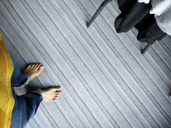 Low section of man standing on carpet