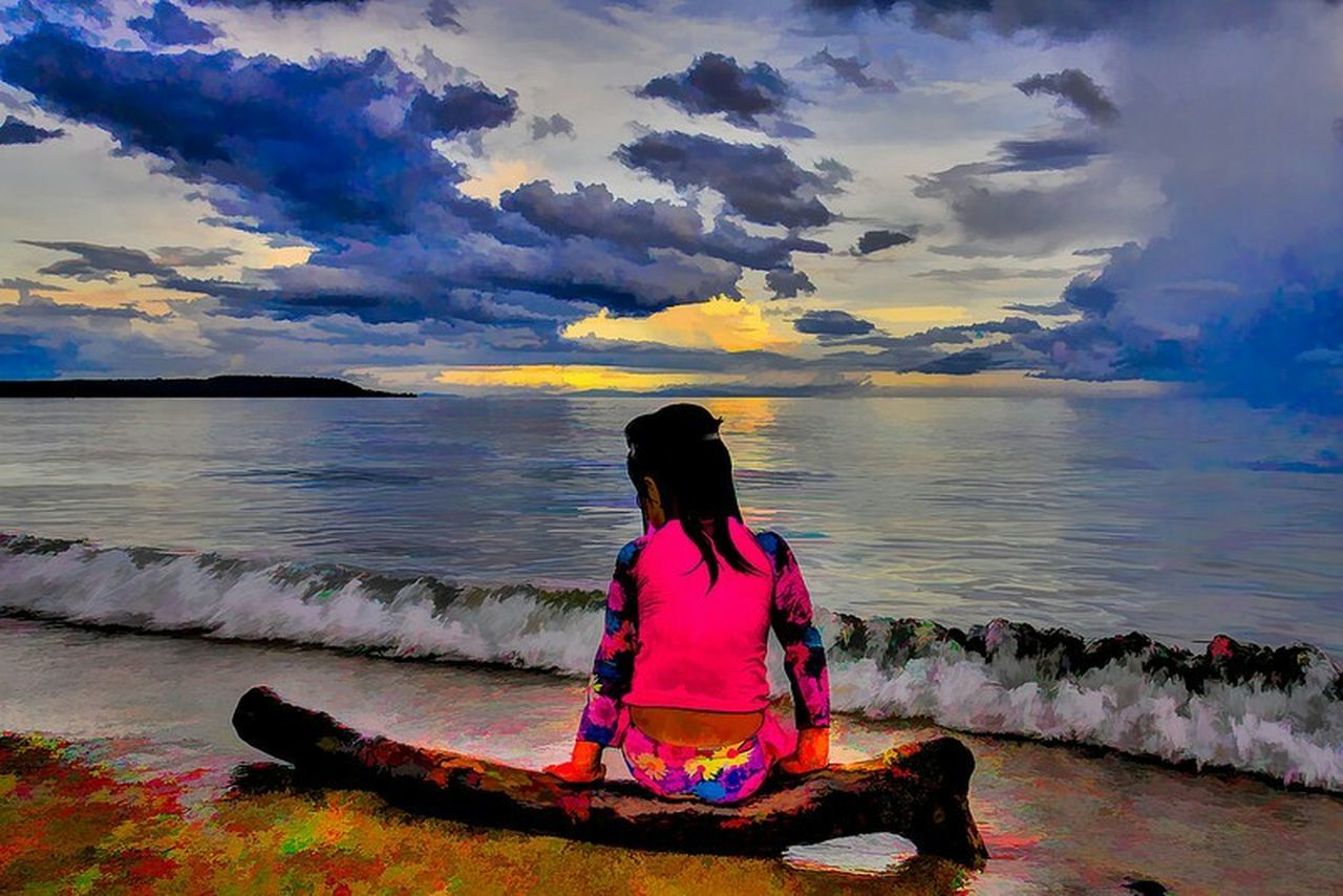sea, water, rear view, sky, sunset, beauty in nature, cloud - sky, scenics, nature, horizon over water, tranquil scene, one person, real people, tranquility, outdoors, women, lifestyles, sitting, beach, full length, day, people