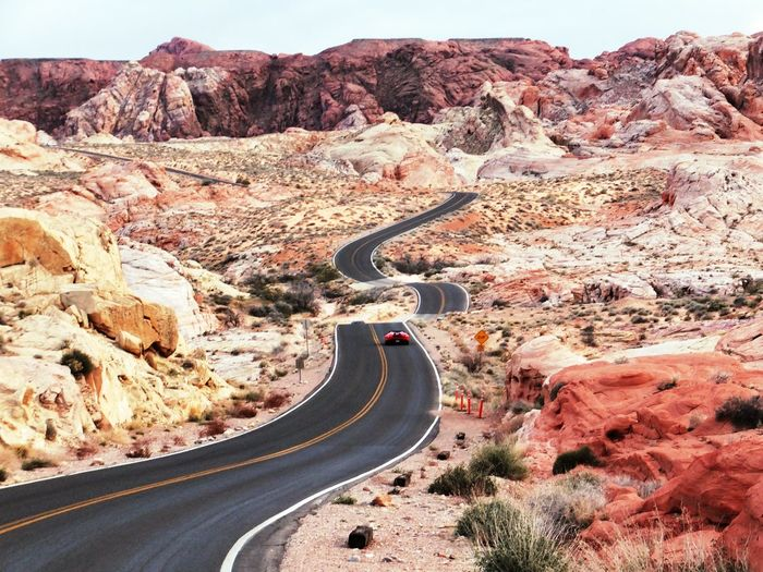 Valley of Fire, Nevada Road Mountain Winding Road Curve Nature Rock - Object Transportation Landscape Scenics Arid Climate Mountain Range Outdoors Beauty In Nature Desert Summer Road Tripping The Traveler - 2018 EyeEm Awards