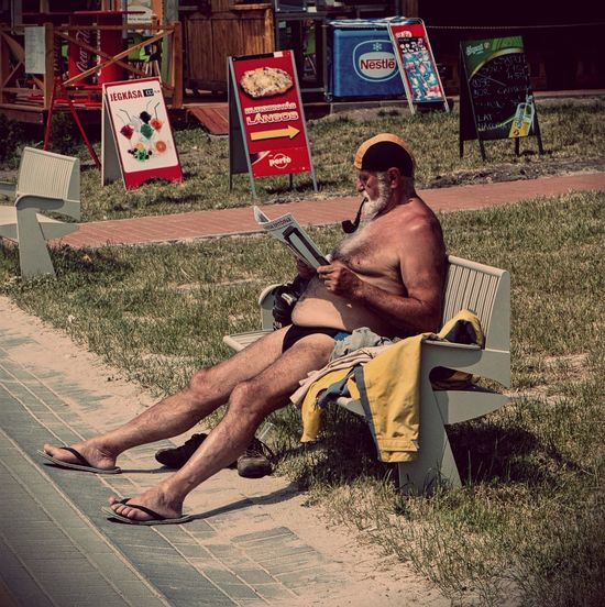 Summerdream Summertime Old Guy Reading and Pipe-smoking In Velencei lake Hungary Funnymoment
