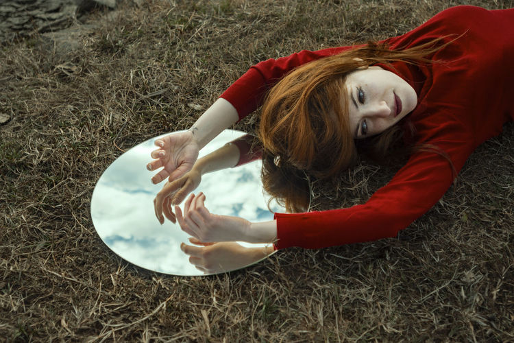 We mirror what we see. One Person Lying Down Land Hair Hairstyle Long Hair Nature Field High Angle View Leisure Activity Lifestyles Women Full Length Day Grass Real People Relaxation Young Adult Outdoors Beautiful Woman Capture Tomorrow EyeEm Best Shots EyeEm Gallery