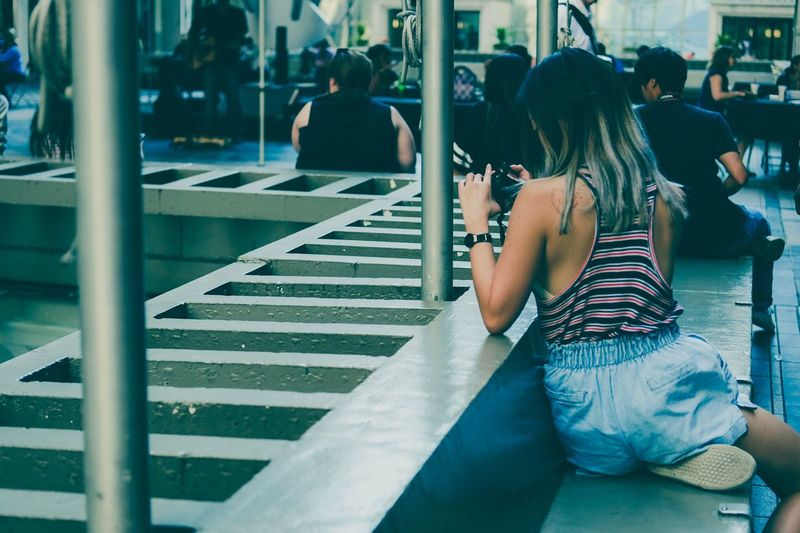 The Week On EyeEm Real People City Streetphotography Street Photography Rear View Sitting Women Lifestyles Leisure Activity Day Standing One Person Indoors  Architecture Adult People EyeEm Selects