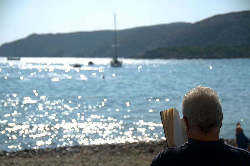 Beach Clear Sky Focus On Foreground Goodlife Leisure Activity Lifestyles Person Quiet Reading Rear View Relax Sea Seaside Things I Like Tranquil Scene Tranquility Water The Essence Of Summer People And Places
