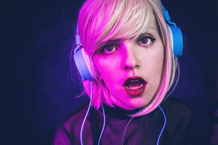 Portrait Headshot One Person Pink Hair Young Adult Looking At Camera Front View Indoors  Dyed Hair Pink Color Hair Studio Shot Hairstyle Young Women Women Close-up Music Lifestyles Black Background Rock Music Purple Beautiful Woman Headphones Dj Party