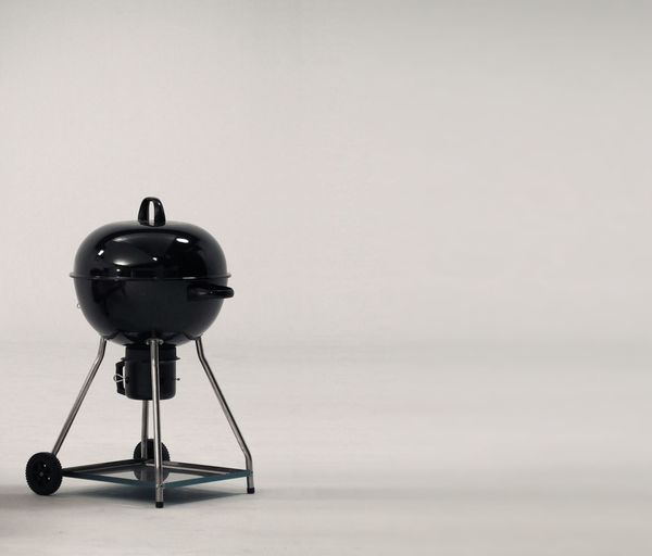 BBQ stove that made from black color steel for party or family picnic and on white background studio. Copy Space Studio Shot Indoors  No People Gray Gray Background White Background Single Object Colored Background Creativity Simplicity Technology Still Life Absence Cut Out Art And Craft Preparation  Metal Grill; Bbq; Barbecue; Isolated; Stove; White; Background; Metal; Clean; Charcoal; Gas; Equipment; Household; Portable; Black; Picnic; Roast; Heater; Cooking; Grilling; Cook; New; Outdoor; Camping; Modern; Kettle; Food; Hot; Steel; Accessory; Appliance; Ov