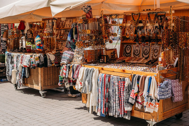 Riga, Latvia. Street Market In Livu Square. Trading Houses With Sale Of Gifts, Sweets And Souvenirs Made From Wood And Amber. Market Textile Sale Shopping Market Riga Latvia Street Square Houses Gifts Sweets Souvenirs Wood Amber Street Market