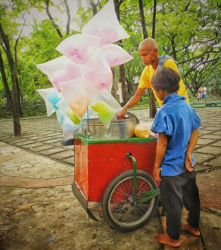 Childhood Food And Drink Fragility Young Cottoncandy Hungry Vendor Emotional Photography Emotion Food Child Wishful Side View Colors Color Explosion Foodcart