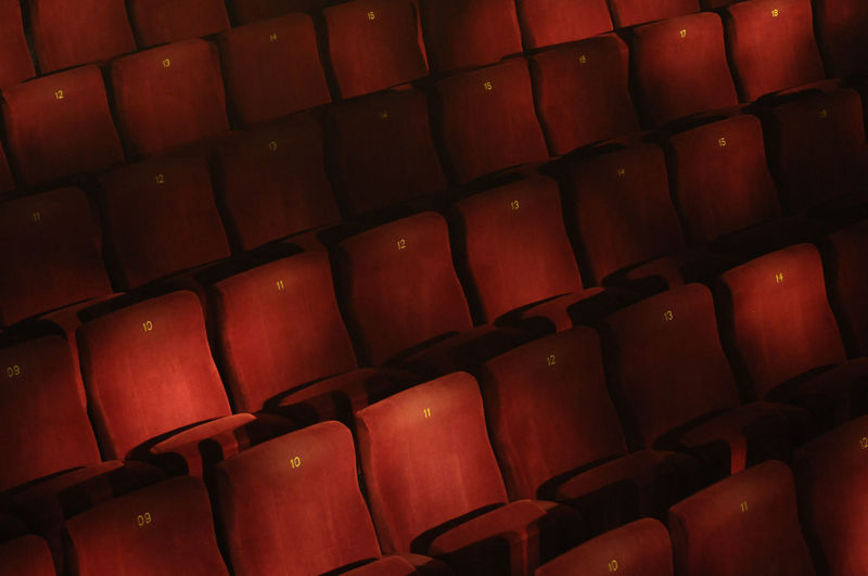 row of red velvet seats in a theater ©alexander h. schulz Auditorium Black Chair Cinema Dark Entertainment Film Industry In A Row Indoor Indoors  Large Group Of Objects Light Minimalism No People Numbers Obscure Red Color Red Velvet Repetition Seat Seat Numbers Seats Seats In A Row Show Velvet