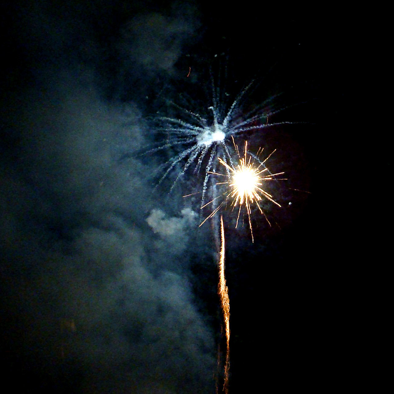 firework display, night, firework - man made object, exploding, low angle view, illuminated, arts culture and entertainment, celebration, long exposure, no people, motion, sky, smoke - physical structure, outdoors, event, firework, nature, close-up