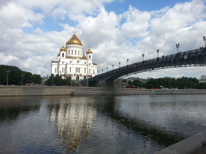 Patriarshy bridge over moskva river by cathedral of christ the saviour against sky