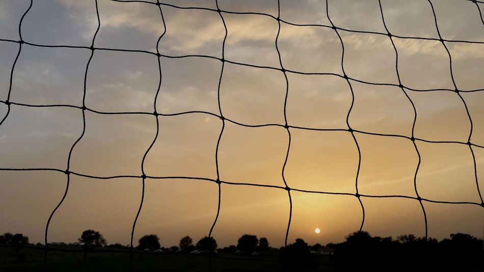 Sky Sport Sunset Fence Nature Net - Sports Equipment Soccer Security Soccer Field Team Sport Silhouette Boundary Protection Pattern Barrier Group Of People Grass Football Safety Land