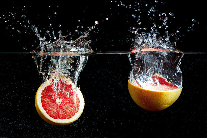 Close-up of sliced orange in water