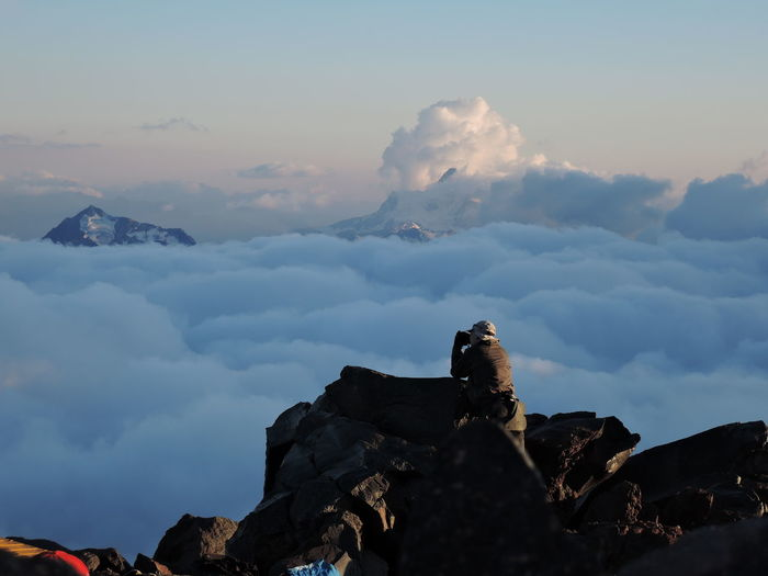 Cloud - Sky Men Mountain Mountain Peak Nature Non-urban Scene On Top Of Sky Tourism Tourist Travel Under Clouds