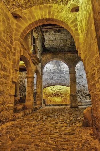 Patio de Old Town Ibiza Eivissa World Heritage World Heritage Site World Heritage Site By UNESCO Dalt Vila Eivissa City Yellow Place Of Worship Ancient Civilization History Ancient Arch Religion Architecture Built Structure