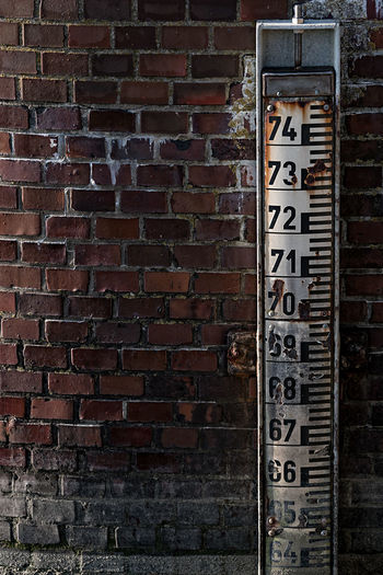 measuring stick Architecture Bar Brick Wall Bricks Built Structure Close-up Communication Day Digits Guidance Measure No People Numbers Outdoors Text Wall - Building Feature Western Script