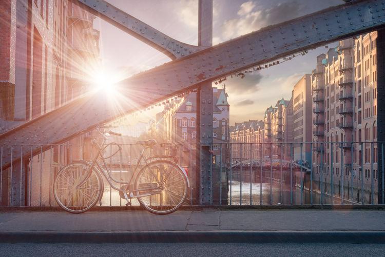 View of bike on bridge during sunset