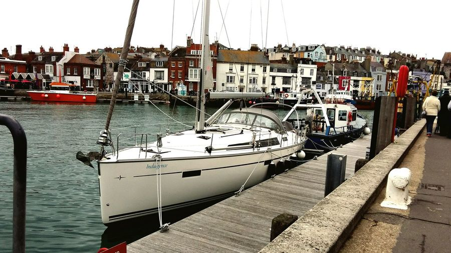 Weymouth Harbour . Featuring Nautical Vessel Mode Of Transport Cloud - Sky Water Harbor Sky Moored Tranquility Sailboat No People Sea Outdoors Day Yacht Sailing Ship Nature Boat Seaside Holiday Built Structure Houses Boats⛵️ Commercial Dock Harbor