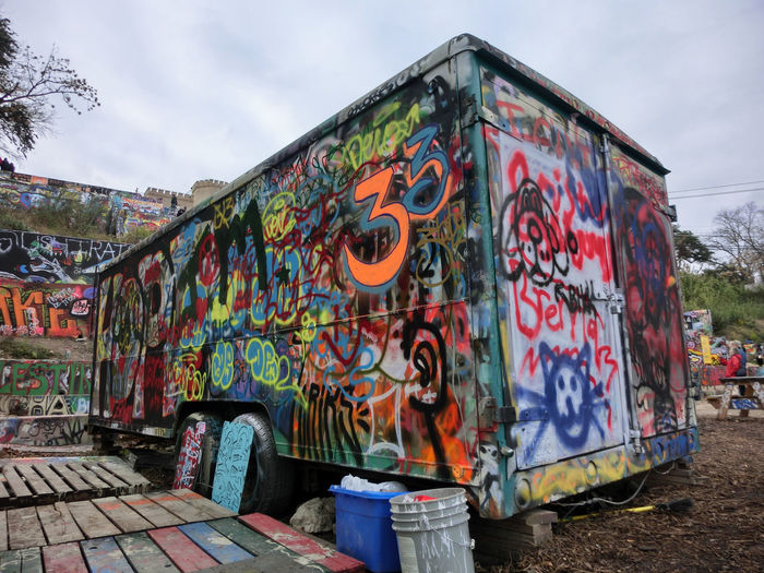 Architecture Built Structure Day Graffiti Multi Colored No People Outdoors Sky Street Art Text