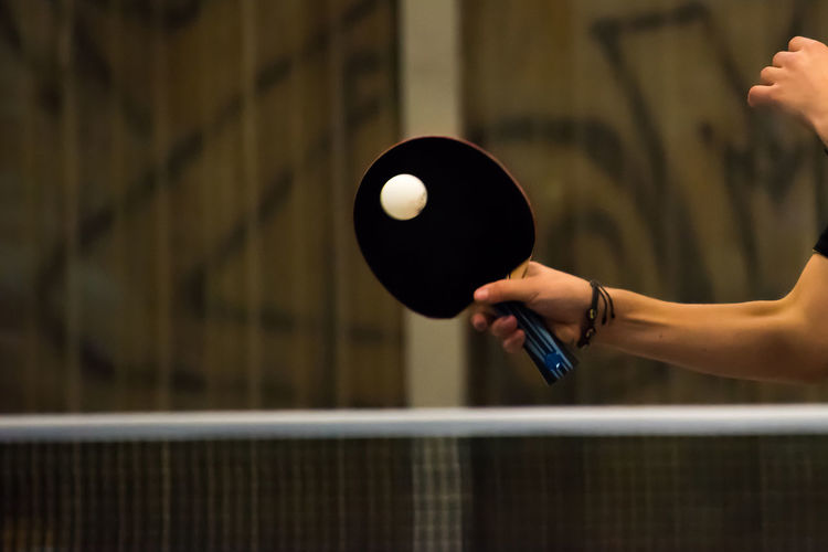 Close-up of hand playing table tennis