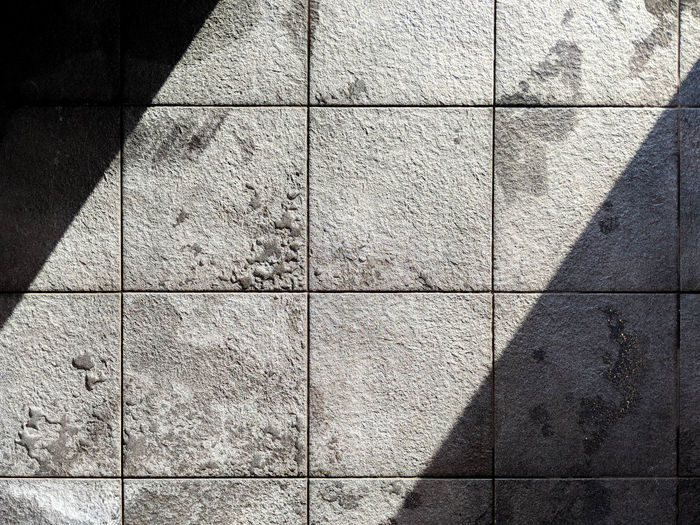 full frame shot of tiled floor Architecture Backgrounds Built Structure Close-up Concrete Day Design Flooring Full Frame Geometric Shape Nature No People Outdoors Pattern Paving Stone Shadow Shape Square Shape Sunlight Textured  Tile Tiled Floor Wall - Building Feature