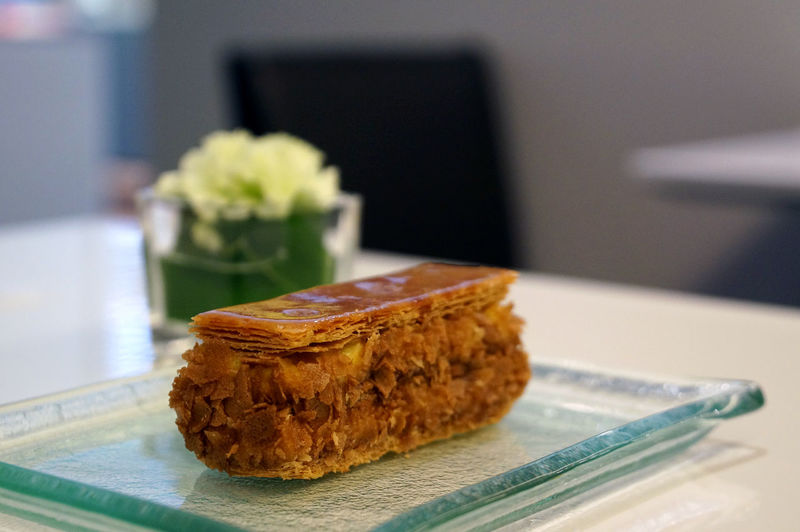 Close-Up Of Fresh Pastry Served In Glass Plate On Table