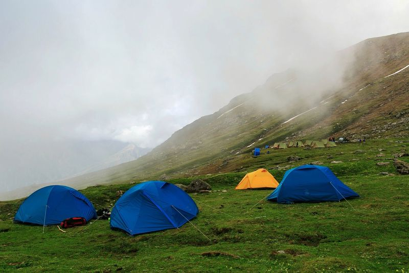 Sleeping in the Clouds. Sar Pass, India. Tent Camping Grass Hill Outdoors Fog Adventure Nature Tea Crop Sky Vacations No People Landscape Beauty In Nature Mountain Range Day Let's Go. Together.