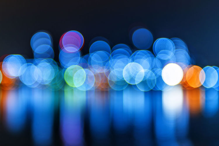 Blurred backgrounds Defocused Blue Illuminated Light - Natural Phenomenon Night Abstract No People Pattern Glowing Circle Backgrounds Geometric Shape Vibrant Color Multi Colored Lighting Equipment Shape Blurred Motion Light Motion Ethereal Black Background Abstract Backgrounds Purple