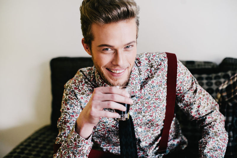 Portrait Of Young Man Having Drink At Home
