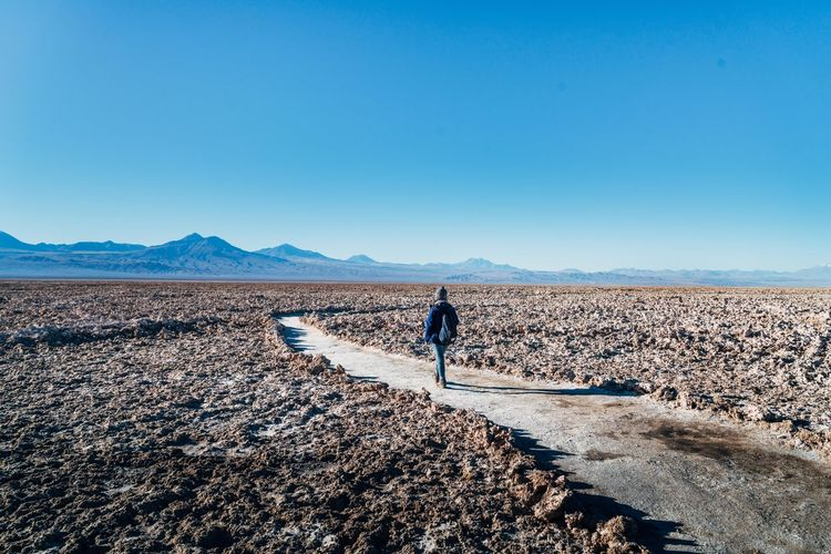 Lost In The Landscape Adult Adults Only Arid Climate Beauty In Nature Blue Clear Sky Day Desert Full Length Landscape Men Mountain Nature One Man Only One Person Only Men Outdoors People Real People Salt - Mineral Salt Basin Salt Flat Scenics Sky Walking