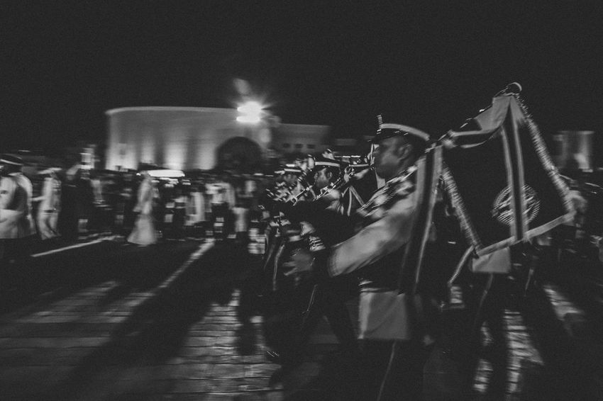 The marching heroes Marching Band Blackandwhite Walking Blurred Motion Night Illuminated Real People Transportation Built Structure Crowd Architecture Outdoors City Building Exterior Group Of People Event Mode Of Transportation Large Group Of People Nature Men Lifestyles Adult Leisure Activity Street