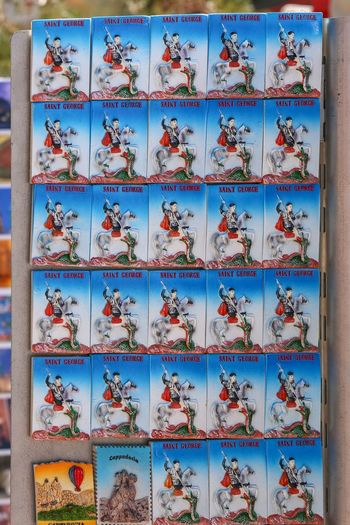 Close-up of books arranged on wall at market stall
