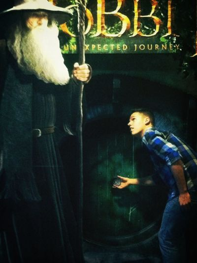 And this is what John does when he sees a giant poster board for The Hobbit...