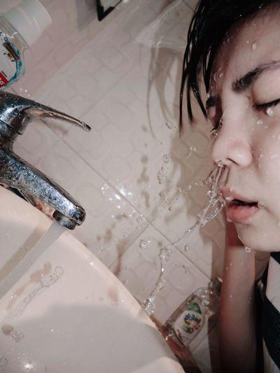 Portrait of young woman in bathtub