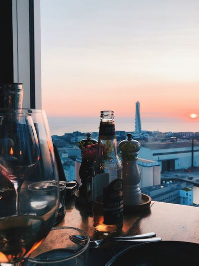 View of wine glass on table at sunset