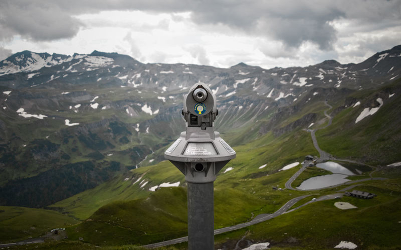 Binoculars against mountains