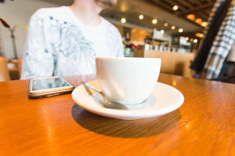 Coffee cup on table in restaurant