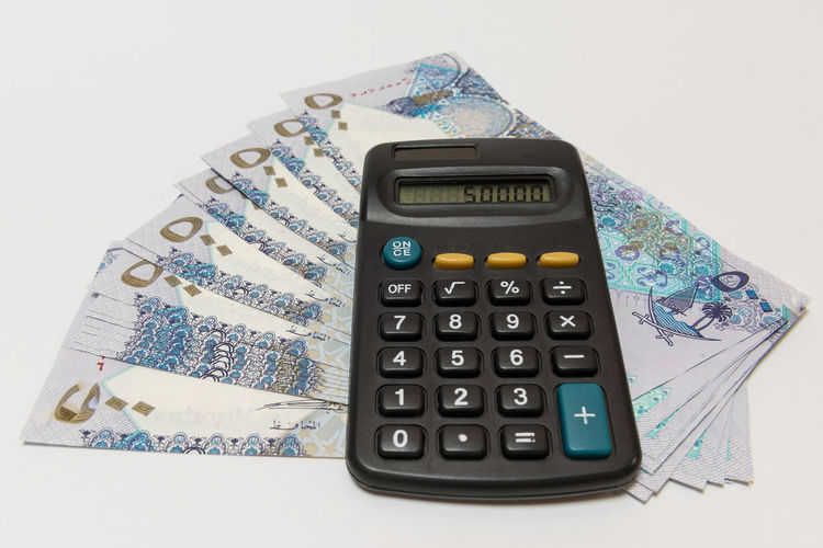 Doha Business Calculator Close-up Currency Debt Economy Finance High Angle View Indoors  Investment Making Money No People Number Paper Currency Qatar Riyal Savings Still Life Studio Shot Wealth White Background