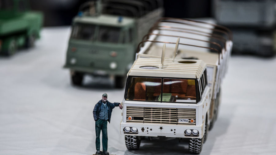 Land Vehicle Mode Of Transportation Transportation City Real People Street People Day Motor Vehicle Focus On Foreground Rear View Men Incidental People Road Truck Car Travel Selective Focus Winter Semi-truck Outdoors