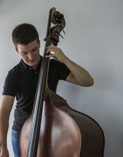 Indoors  Men Young Adult Playing Performance Studio Shot Front View Music Arts Culture And Entertainment Musical Instrument People One Person One Man Only Musician Motion