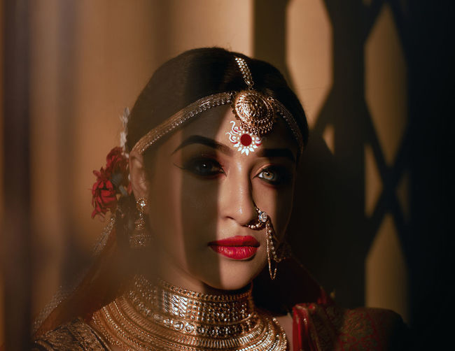 Portrait of beautiful bride against wall