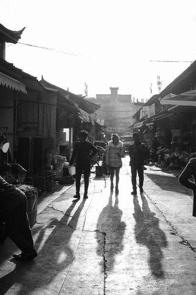 EyeEmNewHere Silhouette Blackandwhite Daylight Gangster Lifestyles Light And Shadow Outdoors People Real People Shadow Streetphotography Sunlight Sunset Walking