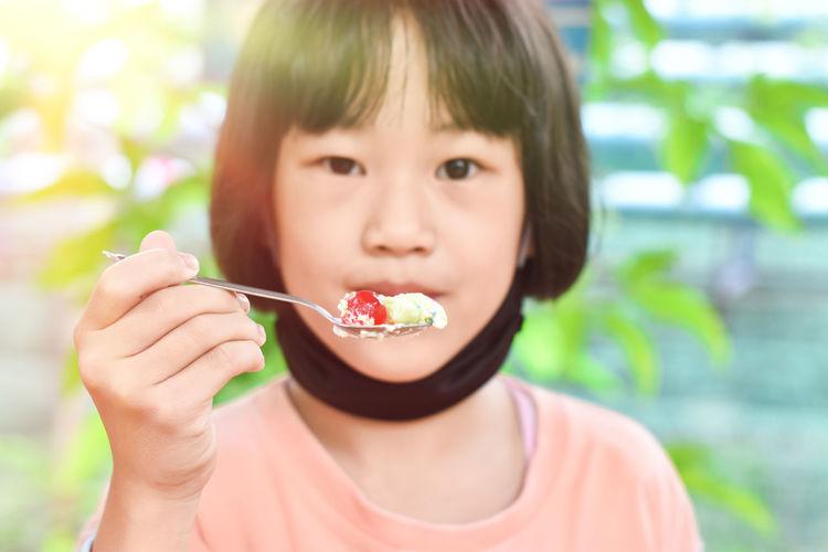 Close-up portrait of boy eating food