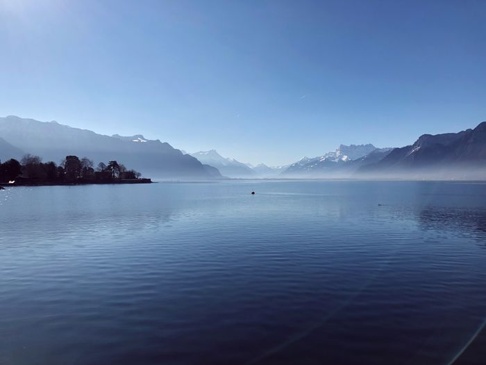 Water Scenics - Nature Beauty In Nature Mountain Sky Tranquil Scene Tranquility Blue Sea No People Non-urban Scene Nature Waterfront Outdoors Mountain Range Idyllic Reflection Travel