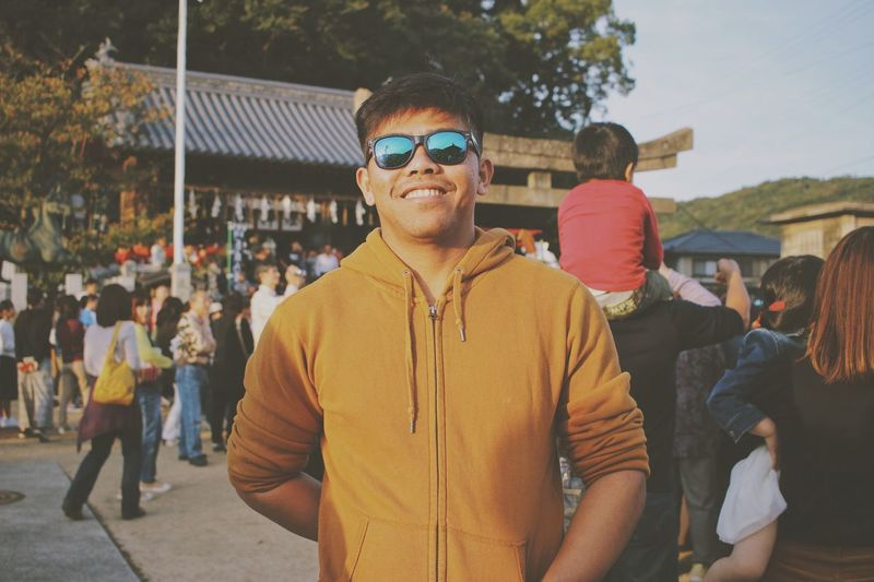 Smile of a millennial man. Man Photography Japan Photography portrait of a friend Traditional Festival Portrait Photography Streetphotography Festival Culture Of Japan Streetphotography Real People Glasses Lifestyles One Person Men Front View Sunglasses Incidental People Casual Clothing Standing Portrait Leisure Activity Fashion Looking At Camera Day Nature Adult Young Men Waist Up Outdoors