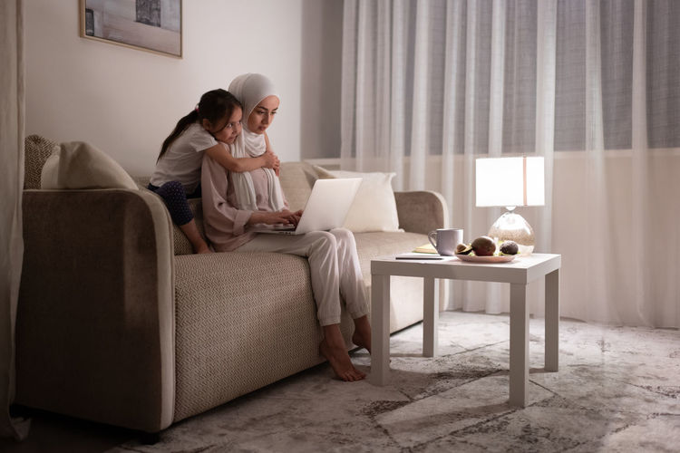 Couple sitting on table at home