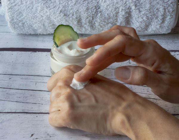homemade cucumber cream, handmade natural cosmetics Hand Human Hand Food And Drink Human Body Part Holding Food Real People Indoors  People Freshness Drink Table Refreshment Finger Close-up Adult Human Finger Body Part High Angle View Glass Cosmetics Natural Cosmetics Skin Acne Antiaging