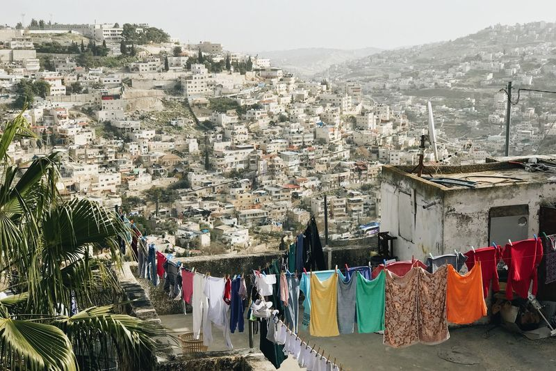 High Angle View Of Clothes Drying On Building Terrace In City