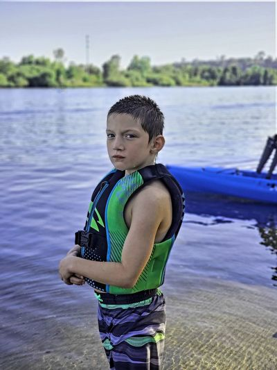 Portrait of boy standing in lake